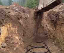 Excavator Burying Geo Tubing
